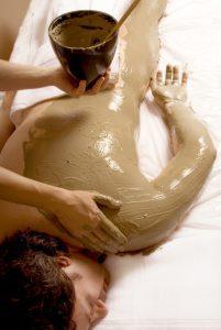 man getting a Full body mud wrap